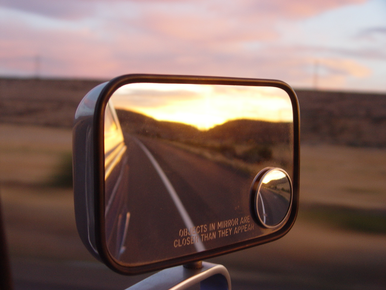 Rearview Mirror Sunset - Transmission Repair - AAMCO Colorado