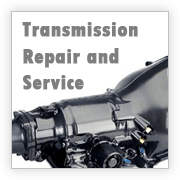 image of transmission in casing, shiny and new, words Transmission Repair and Service overlaid.