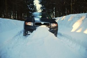 Image - SUV in deep snow - Winter Driving Myths