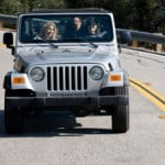 Preparing for Road Trip - Women Riding in Jeep - AAMCO Colorado