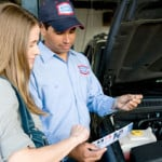 AAMCO employee helping customer - Transmission Repair - Transmission Service - AAMCO Colorado