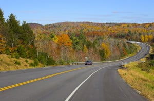 Image of winding highway surrounded by fall foliage and bright autumn colors