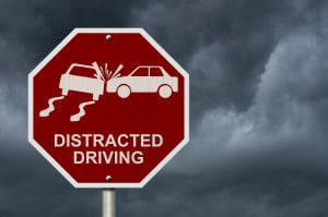 image - red sign that says distracted driving with icon of cars crashing