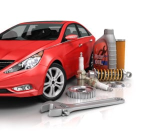 image - large auto parts and tools with shiny red car.