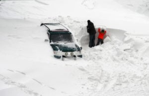 image of Cars covered in snow after a blizzard.