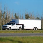 image of truck towing trailer