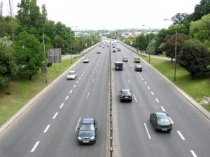 image of highway with traffic, two lanes in either direction.