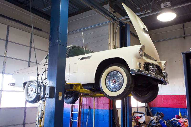 image of aamco aurora shop at hampden tower - interior of shop, work bay - classic car on lift