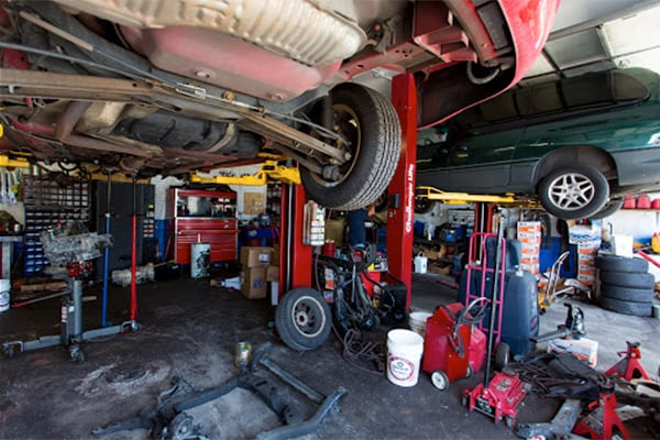 image of interior AAMCO Denver Transmissions and Car Repair shop with cars on lifts.