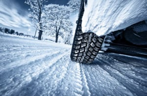 image of car driving on snow packed road pov tire