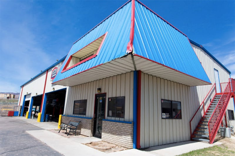 image of AAMCO Colorado Springs transmission and auto repair shop exterior showing repair bays