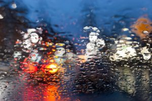 Image of water droplets on a windshield during a rainstorm in Colorado