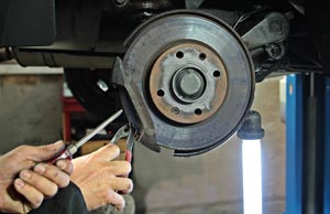 image of a mechanic changing a brakepad