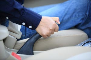 image of a hand gripping emergency/parking brake