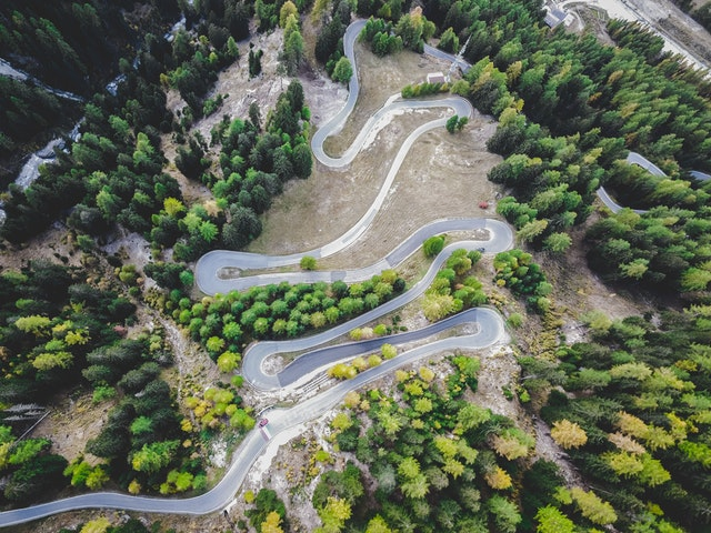 overhead photo of winding mountain road