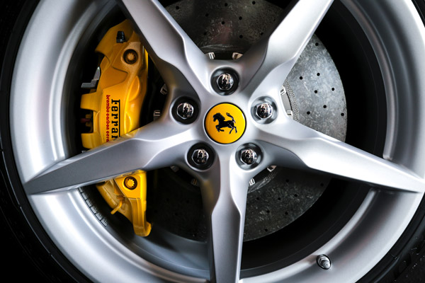 image of a yellow brake caliper in wheel of Ferrari