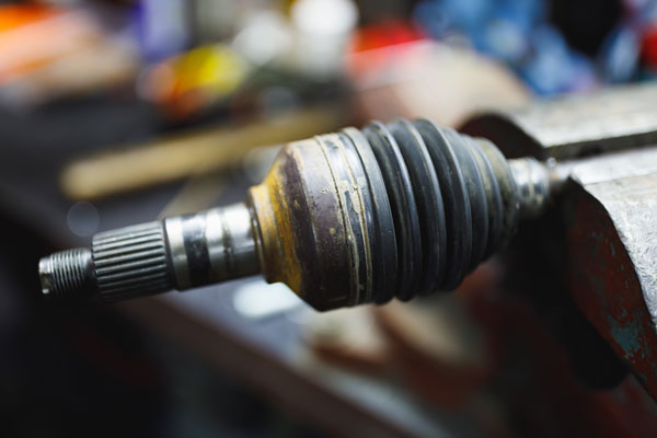 image of a car cv joint in a vice clamp